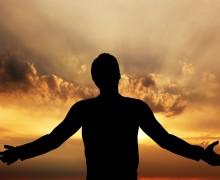 Man praying, meditating in harmony and peace at sunset. Religion, spirituality, prayer, peace.