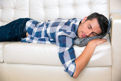 man-resting-sofa-home-portrait-young-cloth-60038700